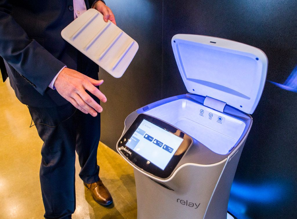 """A Savioke Relay robot butler, nicknamed """"botler,"""" made to help with deliveries to guest rooms, is demonstrated by Robert Buehler, regional director of sales at Savioke Service Robots, on Thursday, March 9, 2017 at Aloft and Element Dallas Love Field hotel in Dallas. The hotel will be part of West Love, an ongoing 37-acre mixed-use development. (Ashley Landis/The Dallas Morning News)"""