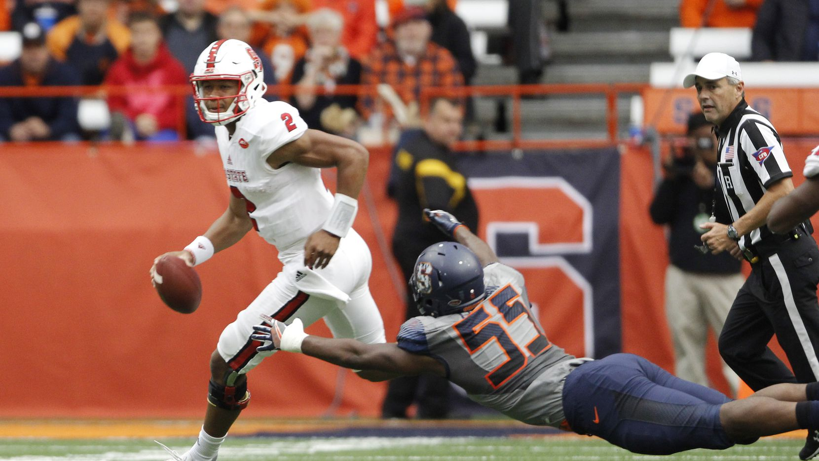 Syracuse's Kendall Coleman, right, dives to tackle North Carolina State's Jalan McClendon, left, in the second quarter of an NCAA college football game in Syracuse, N.Y., Saturday, Nov. 12, 2016. (AP Photo/Nick Lisi)