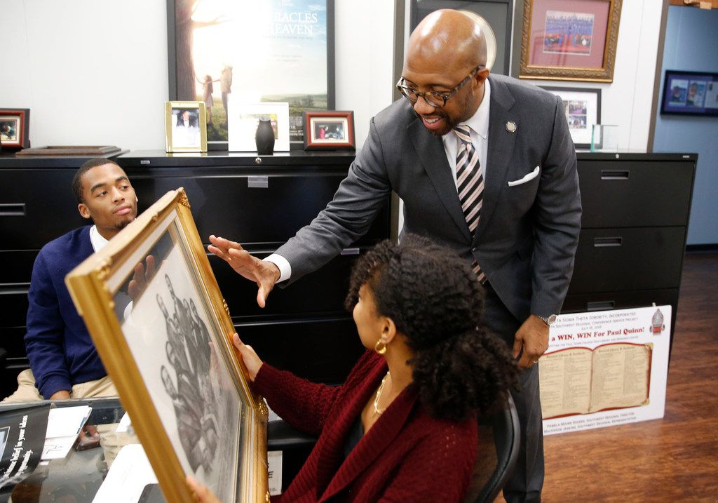 Michael Sorrell, president of Paul Quinn College, talks to Aden Jemaneh of Irving about a piece of artwork as Jaiyer Jinwright of Newark, N.J., looks on at Paul Quinn College in Dallas.