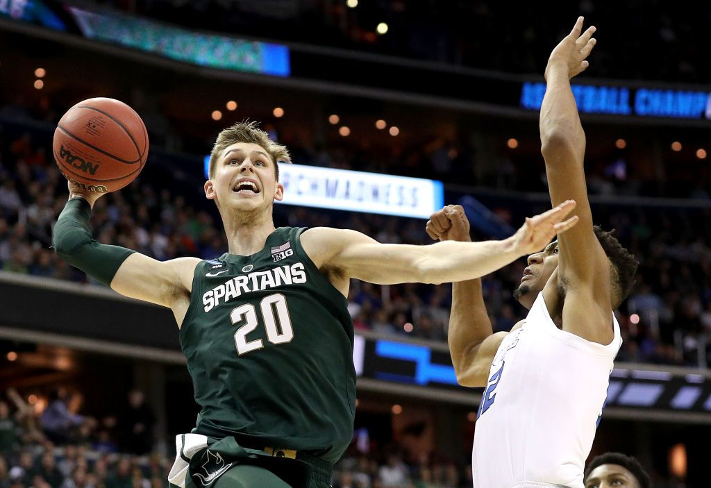 WASHINGTON, DC - MARCH 31:  Matt McQuaid #20 of the Michigan State Spartans dunks the ball against the Duke Blue Devils during the first half in the East Regional game of the 2019 NCAA Men's Basketball Tournament at Capital One Arena on March 31, 2019 in Washington, DC. (Photo by Patrick Smith/Getty Images)