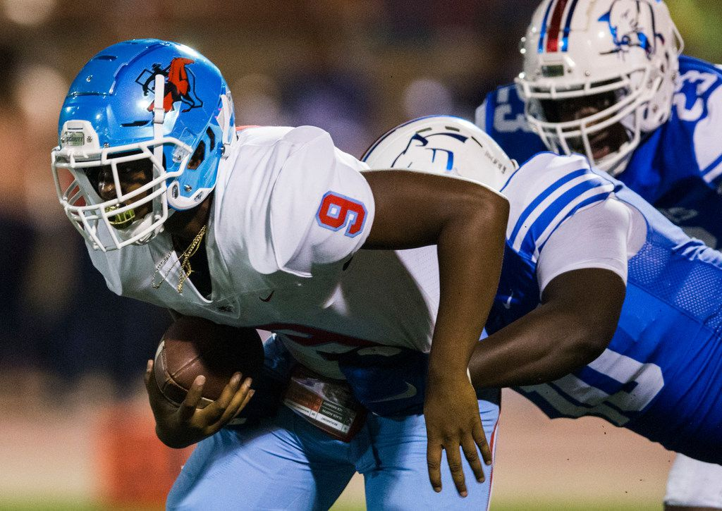 Skyline quarterback Darryl Richardson (9) is sacked by Duncanville defensive lineman Kevon Ivy (10) during the second quarter of a high school football game between Skyline and Duncanville on Friday, October 4, 2019 at Panther Stadium in Duncanville. (Ashley Landis/The Dallas Morning News)