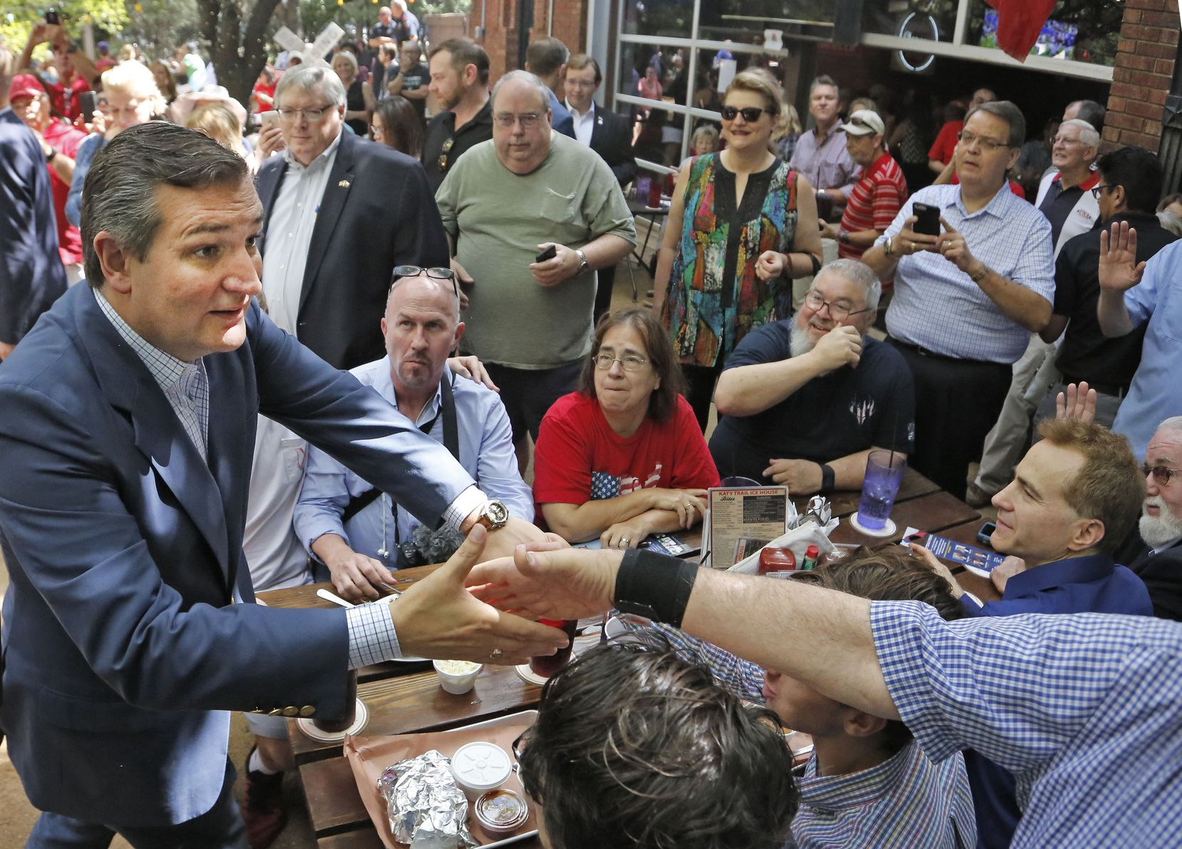 Sen.Ted Cruz works the crowd as he campaigns at the Katy Trail Ice House Outpost in Plano on Thursday, Oct. 4, 2018.