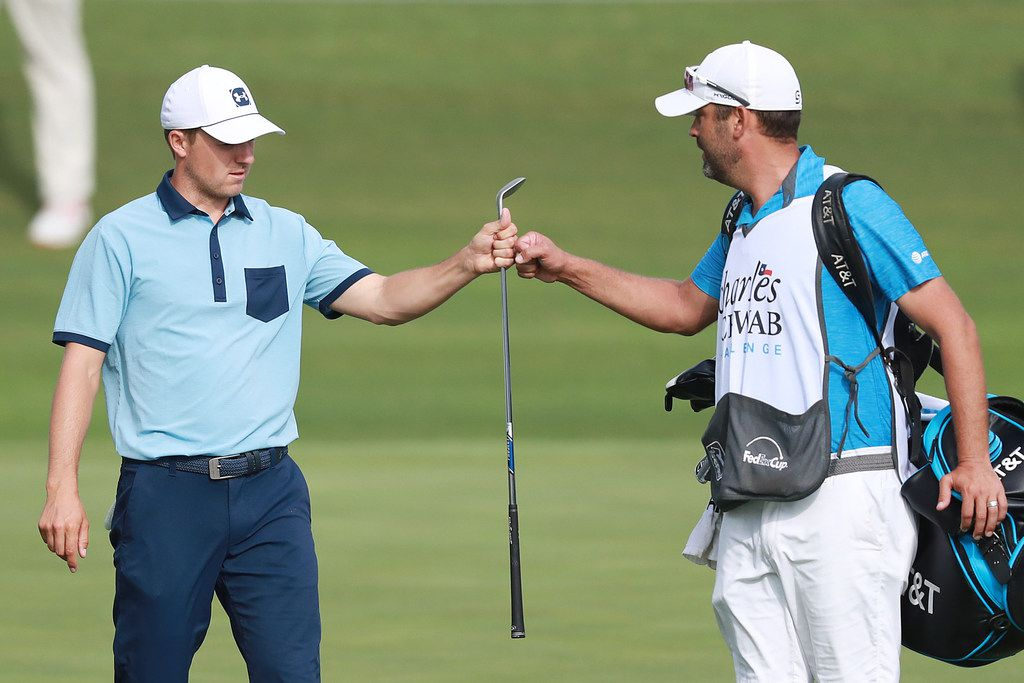 Jordan Spieth of the United States celebrates with caddie, Michael Greller, after a birdie on the 13th hole during the first round of the Charles Schwab Challenge at Colonial Country Club on May 23, 2019 in Fort Worth, Texas. (Photo by Tom Pennington/Getty Images)