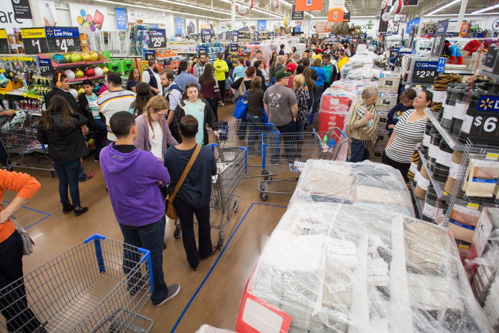Customers save big at Walmart's Black Friday shopping event on Thursday, Nov. 26, 2015 in Rogers, Ark.