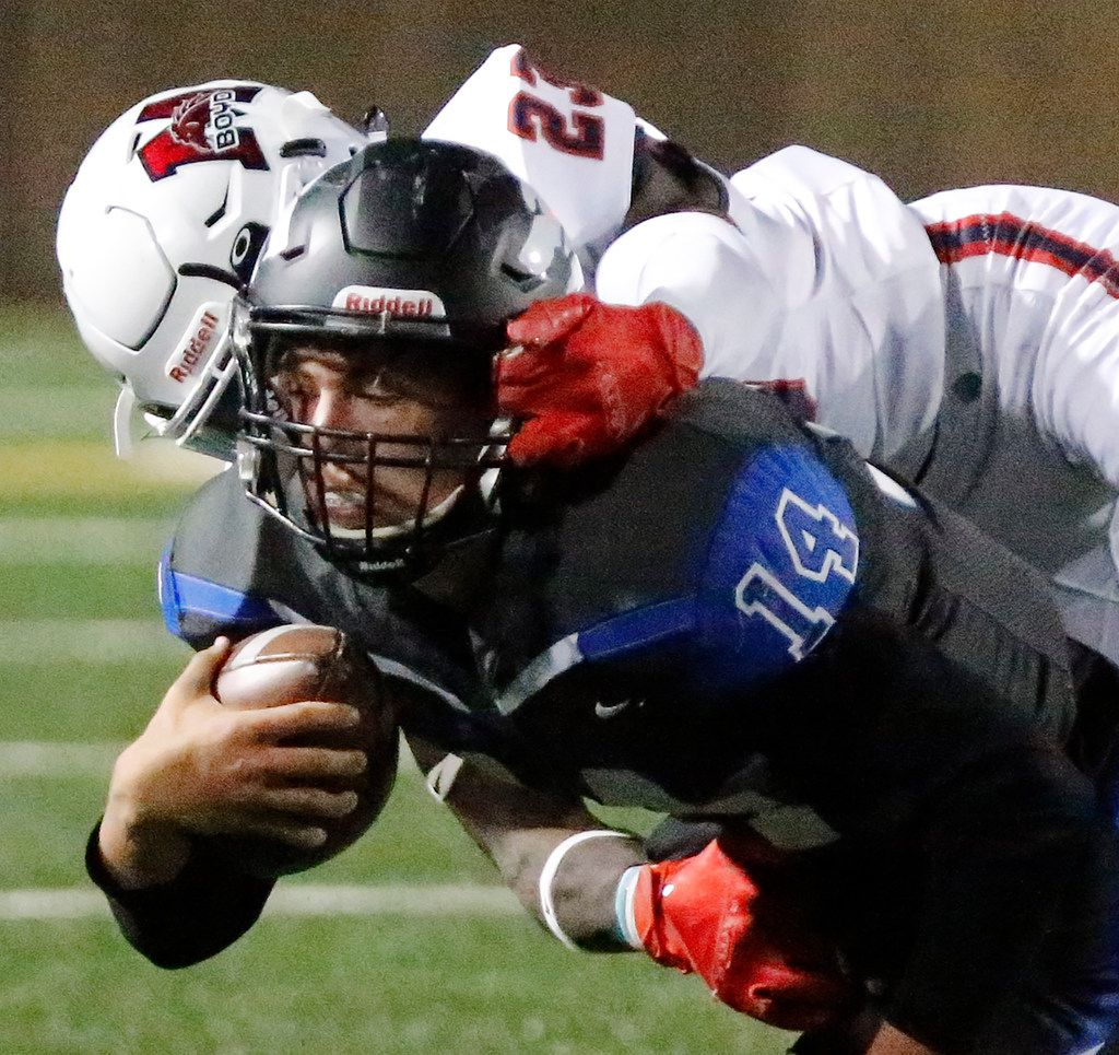 Plano West High School quarterback Andrew Picco (14) is face masked by McKinney Boyd High School cornerback Treveon Collins (23) during the first half as Plano West High School hosted McKinney Boyd High School at Clark Stadium in Plano on Friday night, October 11, 2019. (Stewart F. House/Special Contributor)