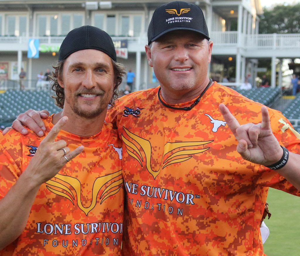 Actor Matthew McConaughey poses with former MLB pitcher Roger Clemens during the Red River celebrity softball game home run contest at the Dr. Pepper Ballpark in Frisco, Texas. (Louis DeLuca/The Dallas Morning News)