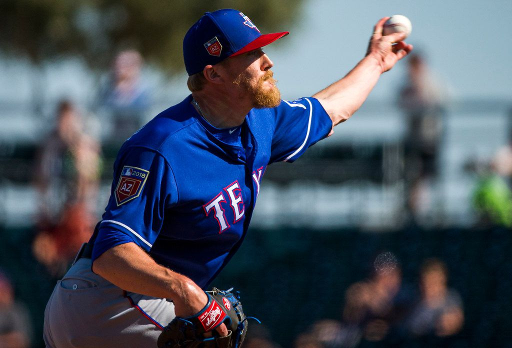 Texas Rangers pitcher Jake Diekman pitches during the fourth inning of a spring training baseball game against the Cleveland Indians on Friday, March 2, 2018, in Goodyear, Ariz. (Smiley N. Pool/The Dallas Morning News)
