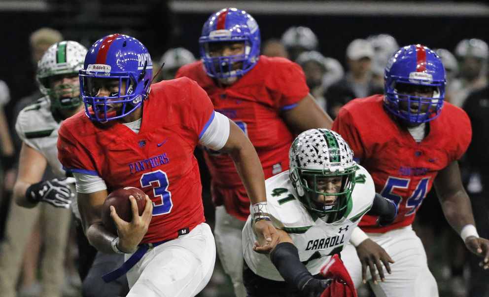 Duncanville quarterback Ja'Quinden Jackson (3) breaks past a Southlake Carroll defender to score a second-quarter touchdown during the Southlake Carroll Dragons vs. the Duncanville Panthers Class 6A Division I Region I high school football playoff game at the Star in Frisco, Texas on Saturday, December 8, 2018.