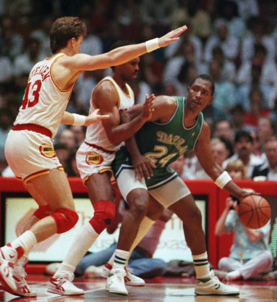 Dallas Mavericks forward Mark Aguirre (24) is pressured by the Houston Rockets defense, including Jim Petersen (43), left, during game 4 of the 1st round of the Western Conference playoffs at The Summit on May 5, 1988 in Houston. The Dallas Mavericks defeated the Houston Rockets 107-97 to clinch the series 3-1.