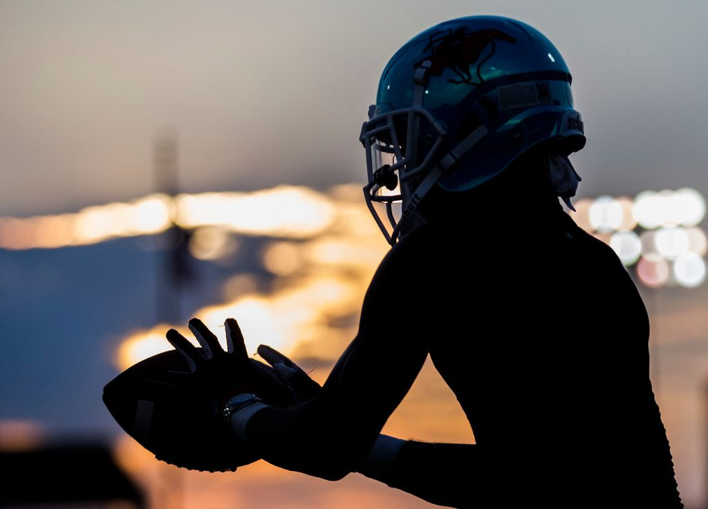 A Skyline football player catches a pass as he warms up before a high school football game between Skyline and Duncanville on Friday, October 4, 2019 at Panther Stadium in Duncanville. (Ashley Landis/The Dallas Morning News)
