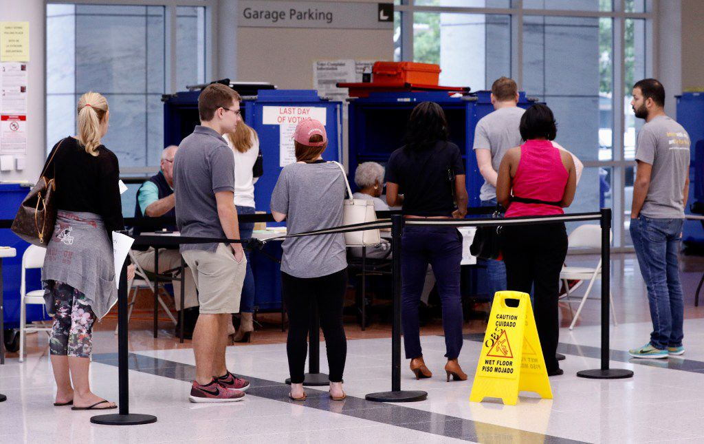 People lined up to vote early at the George L. Allen Sr. Courts Building in downtown Dallas on Friday. (David Woo/Staff Photographer)