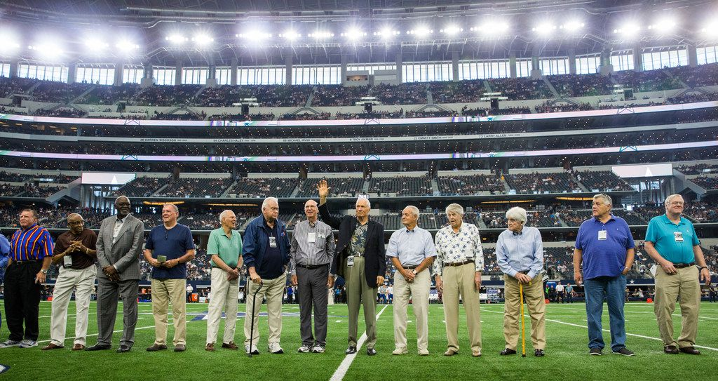 Former Dallas Cowboys player Bob Lilly, (waving, center), and others are honored on the field before an NFL football game between the Los Angeles Rams and the Dallas Cowboys on Sunday, October 1, 2017 at AT&T Stadium in Arlington, Texas. (Ashley Landis/The Dallas Morning News)