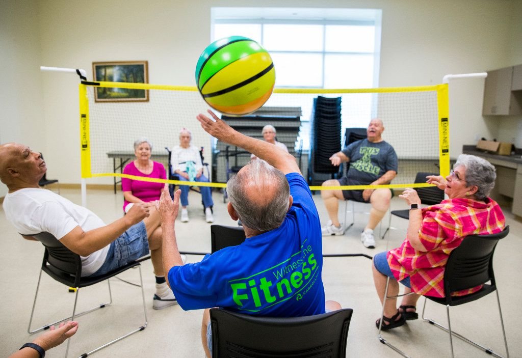 Dan Smith, center, plays chair volleyball with other seniors in September, 2016 at the Carrollton Senior Center in Carrollton.