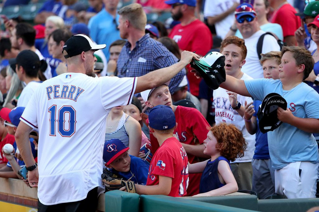 ARLINGTON, TEXAS - JULY 17: Corey Perry of the Dallas Stars signs autographs for fans before the Texas Rangers take on the Arizona Diamondbacks at Globe Life Park in Arlington on July 17, 2019 in Arlington, Texas. (Photo by Tom Pennington/Getty Images)