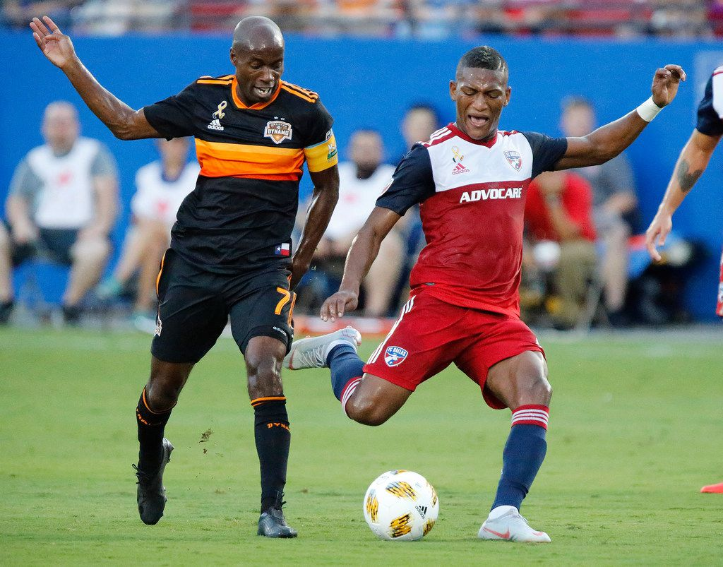 FC Dallas midfielder Carlos Gruezo (7) attempts a shot next to Houston Dynamo midfielder DaMarcus Beasley (7) during the first half as FC Dallas hosted Houston Dynamo at Toyota Stadium in Frisco on Saturday , September 1, 2018.  (Stewart F. House/Special Contributor)