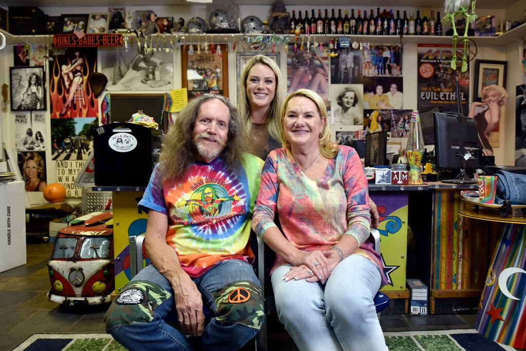 """Owner Rick Fairless, his daughter and marketing manager, Lena """"Bigun"""" Fairless Lee, and Rick's wife, Susan Fairless, store manager, inside Rick's office at Strokers Dallas."""