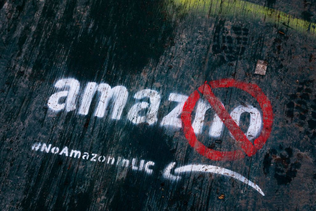 In this Nov. 16, 2018, file photo graffiti has been painted on a sidewalk by someone opposed to the location of an Amazon headquarters in the Long Island City neighborhood in the Queens borough of New York. Amazon said Feb. 14, 2019, that it will not be building a new headquarters in New York, a stunning reversal after a yearlong search. The online retailer has faced opposition from some New York politicians, who were unhappy with the tax incentives Amazon was promised.