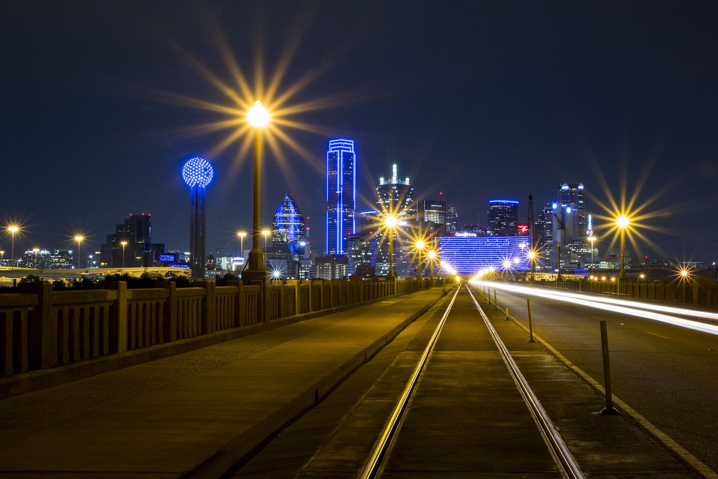 The downtown Dallas skyline lights up in blue in recognition of National Police Week as seen from the Houston Steet Viaduct on Monday, May 15, 2017. (Smiley N. Pool/The Dallas Morning News)
