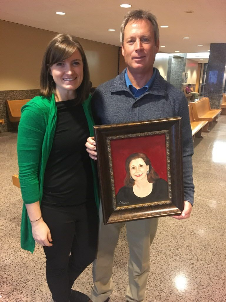 Caitlin Martin-Linduff and Don Martin were presented with a hand-painted portrait of Kellie Martin by the family of Floella Brown during a break in testimony in the sentencing phase of Christopher Duntsch's trial.