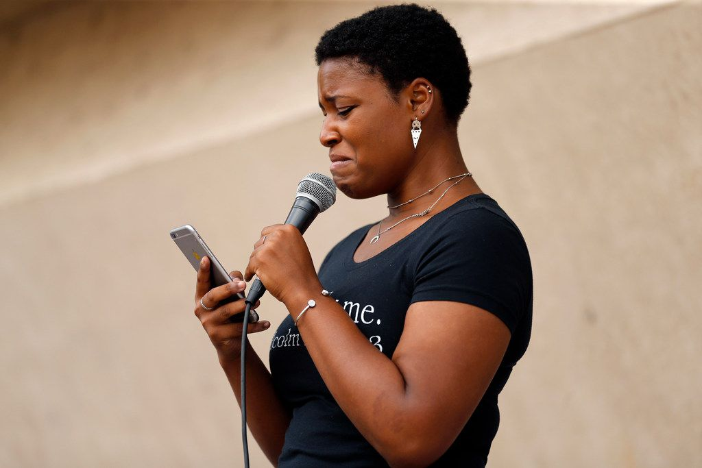 Guest speaker Alona Kemp weeps as she reads her speech for those gathered at Saturday's rally at Dallas City Hall.