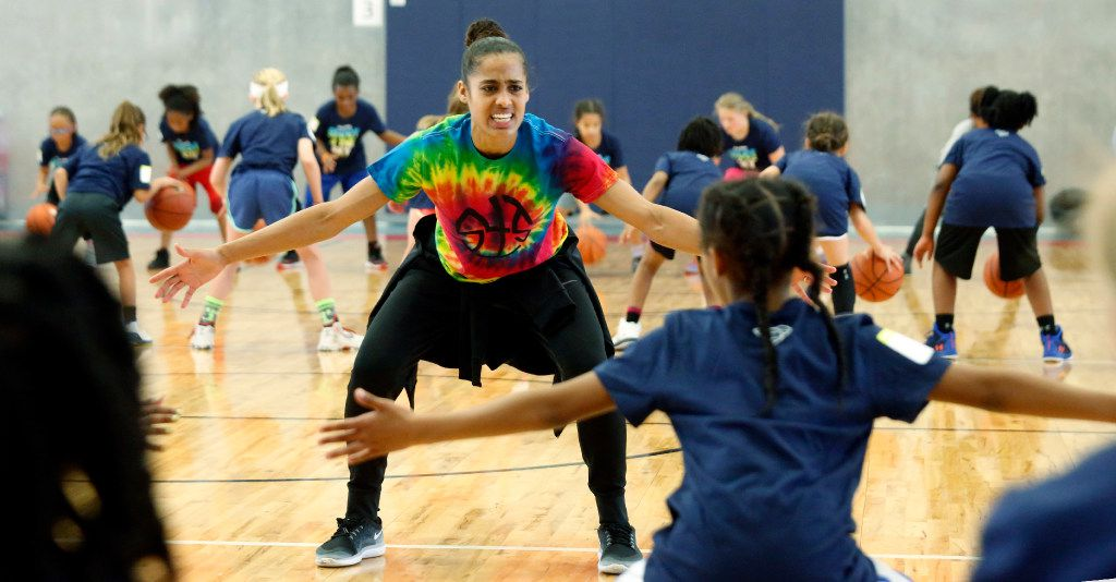 """Dallas Wings star Skylar Diggins  leads a defense drill at her basketball camp """"Shoot 4 The Sky"""" at the Plano Sports Authority in Murphy Saturday April 1, 2017. (Ron Baselice/The Dallas Morning News)"""