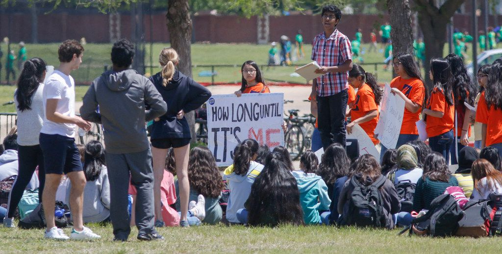 Students at Plano ISD's Jasper High School gather on school grounds for the National School Walkout in Plano, Texas Friday, April 20, 2018. The walkout is in conjunction with the 19th anniversary of the Columbine shooting and other school shootings. (Ron Baselice/The Dallas Morning News)