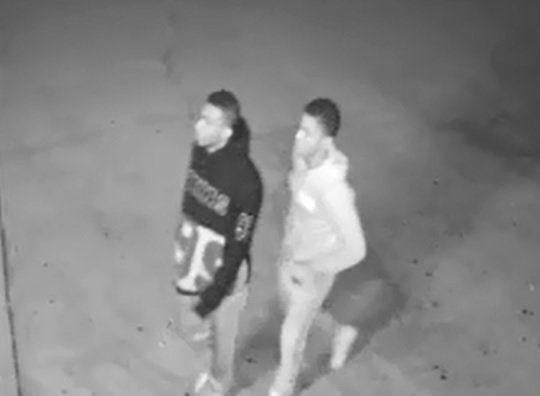 Two men accused of robbing a woman at gunpoint outside of a Fort Worth bar.