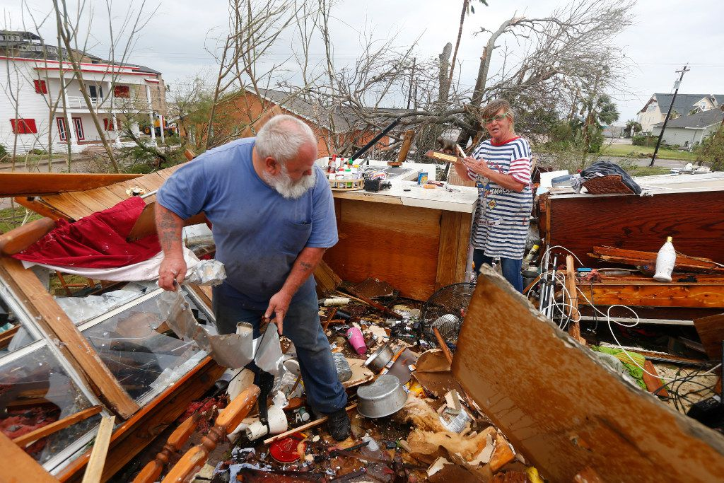 Bill and Paulette Rogers search for the second story of their home his wallet after Hurricane Harvey destroyed their house in Port Aransas, Texas on Aug. 26, 2017.   (Nathan Hunsinger/The Dallas Morning News)