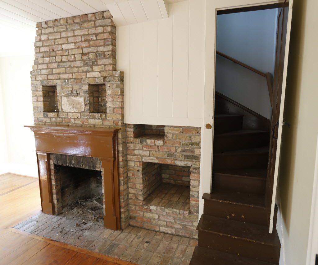 The original stairs and a fireplace at Collinwood House in Plano on  Nov. 6, 2014.