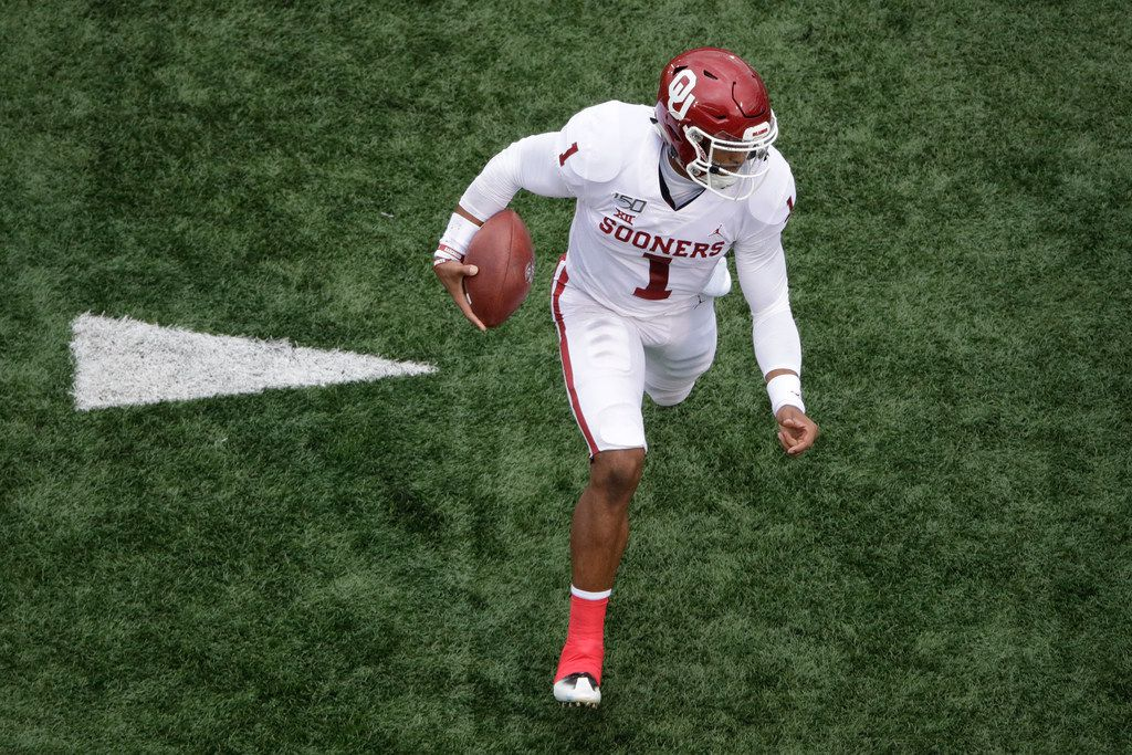 Oklahoma quarterback Jalen Hurts (1) runs the ball during the first half of an NCAA college football game against Kansas Saturday, Oct. 5, 2019, in Lawrence, Kan. (AP Photo/Charlie Riedel)