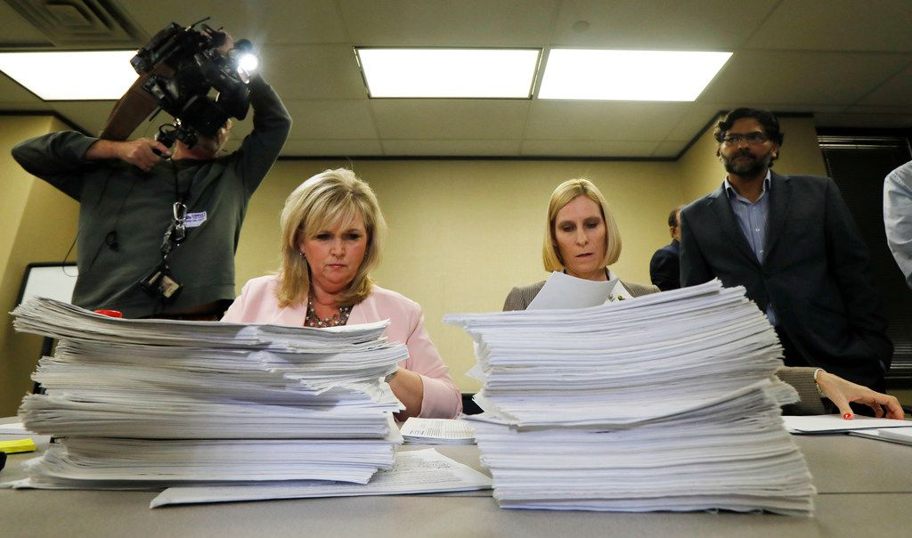 """Plano city secretary, Lisa Henderson, left, and Alice Snyder, assistant city secretary count signatures at Plano City Hall from residents of Plano and Our Plano, One Plano, submitted petitions with signatures to recall council member Tom Harrison over """"inflammatory, islamophobic, racist and otherwise offensive communications detrimental to the social and economic well-being of our diverse community, Wednesday, March 4, 2018. (David Woo/The Dallas Morning News)"""