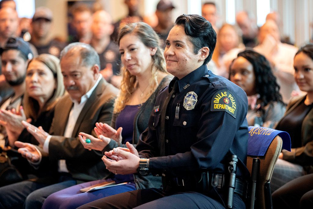 Dallas police officer Crystal Almeida claps after hearing Chief U. Renee Hall, not pictured, commend her service, before receiving the Theodore Roosevelt Police Award on Thursday, April 11, 2019 at the Jack Evans Police Headquarters in Dallas.