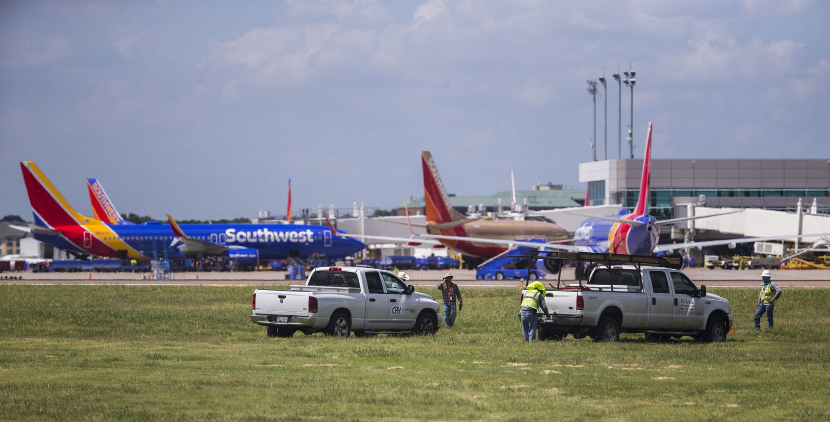 CP&Y, Inc. employees work as Southwest Airlines airplanes are parked at terminals while computer systems recover on Wednesday, July 20, 2016 at Dallas Love Field Airport in Dallas. (Ashley Landis/The Dallas Morning News)