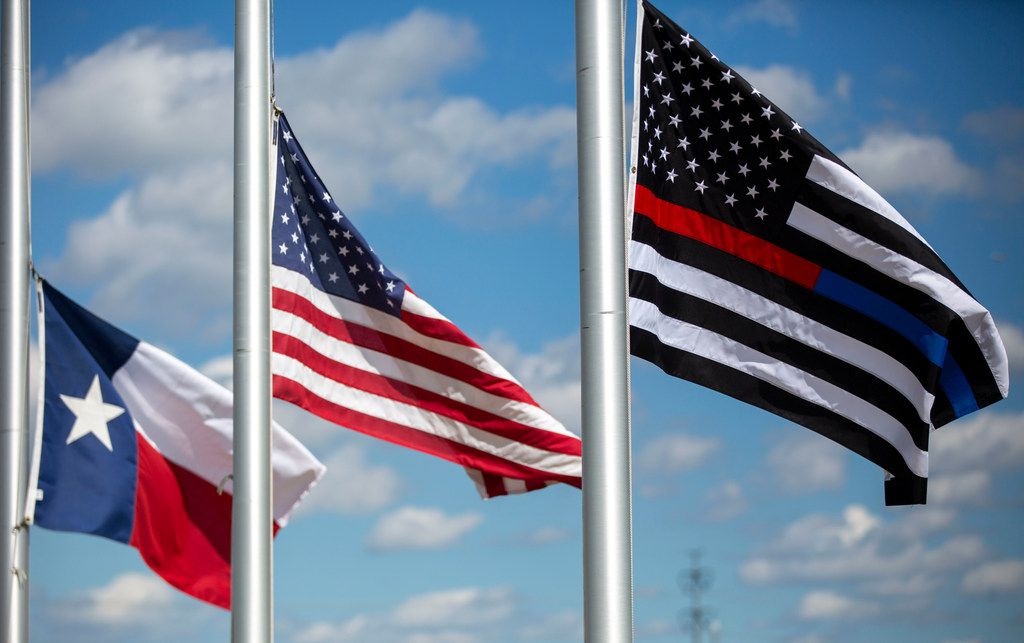 Flags at the Grand Prairie Police Department flew at half-staff Friday in memory of Officer A.J. Castaneda.