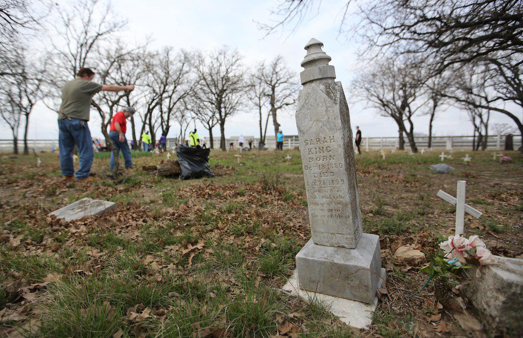 Volunteers work to clean up Shelton's Bear Creek Cemetery in Irving on Saturday, March 10, 2018. The cemetery was discovered in 1995 and a book was written about the site. The cemetery gained historical landmark status in 2000.