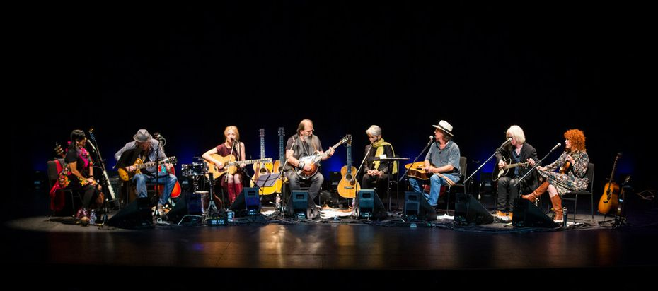 From left: Lila Downs, David Pulkingham, Patty Griffin, Steve Earle, Joan Baez, James McMurtry, Chris Masterson and Eleanor Whitmore perform at Lampadusa: Concerts for Refugees at the Majestic Theatre in downtown Dallas.