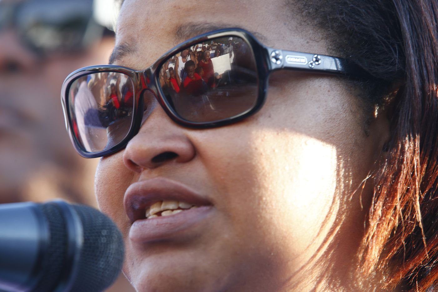 Shaquna Persley, Shavon Randle's mother, speaks during a vigil for her daughter.