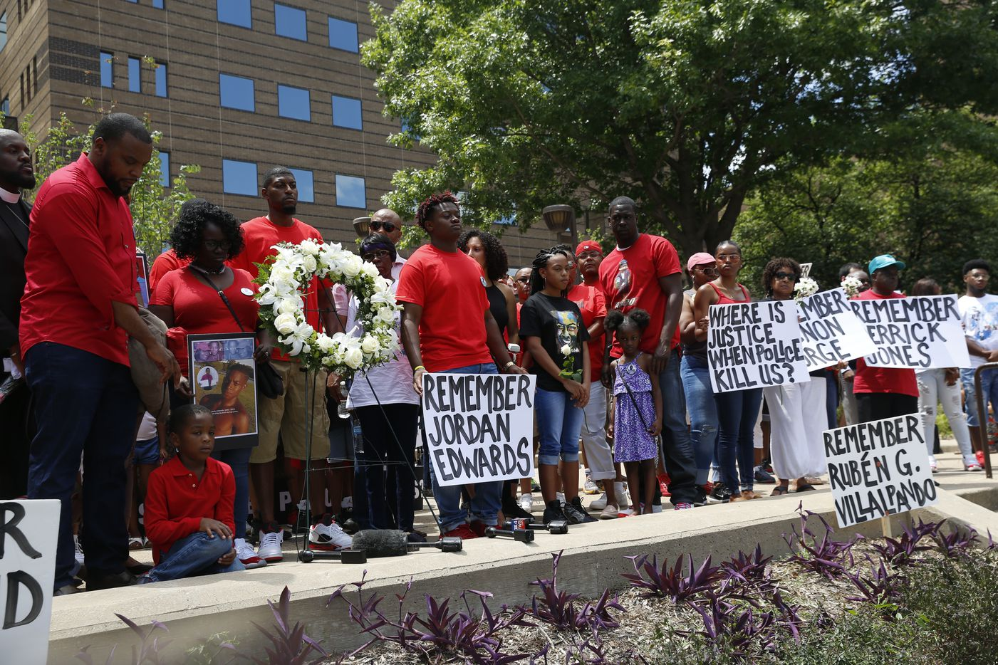 A crowd gathers, from left, including Lee Merritt, Charmaine Edwards, Odell Edwards on the steps of the Frank Crowley Courts Building in Dallas Saturday May 13, 2017.