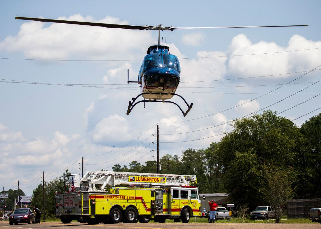 Medical helicopters land in front of the Lumberton Central Fire Department to carry critical patients to hospitals in other cities on Friday, September 1, 2017 in Lumberton, Texas.