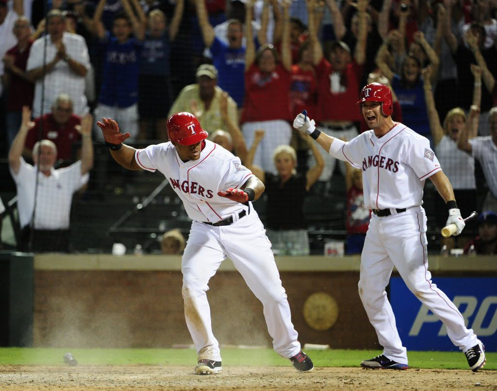 Texas Rangers third baseman Adrian Beltre (29) and first baseman Michael Young (10) celebrate after Beltre scored on a double by Nelson Cruz, as they defeated the Minnesota Twins at Rangers Ballpark in Arlington on Saturday, July 7, 2012. Texas beat the Minnesota Twins 4-3 in 10 innings. (Michael Ainsworth/ The Dallas Morning News)