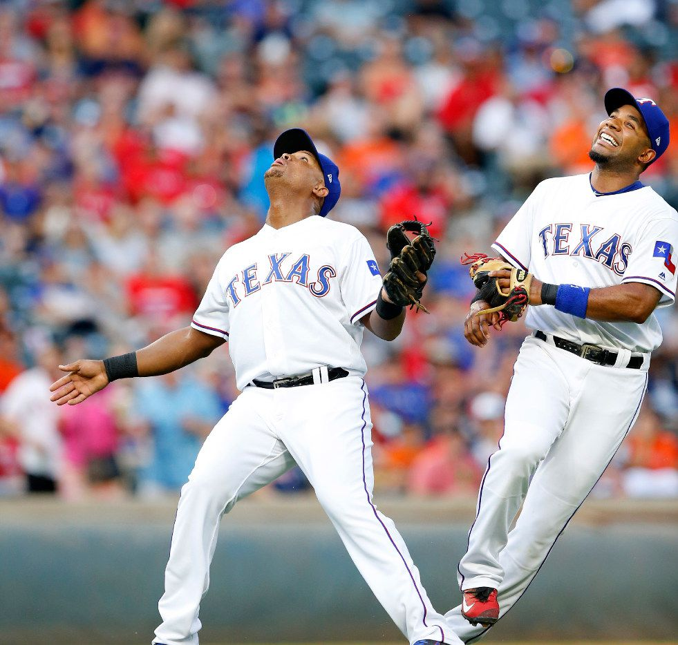 Texas Rangers third baseman Adrian Beltre (left) calls off shortstop Elvis Andrus on a pop-up by Houston Astros Marwin Gonzalez in the second inning at Globe Life Park in Arlington, Friday, August 11, 2017. (Tom Fox/The Dallas Morning News)