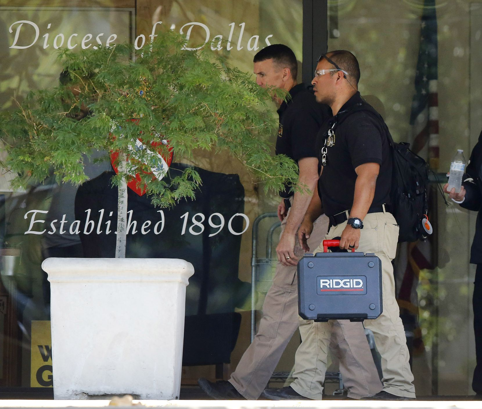 Law enforcement officials worked Wednesday at the offices of the Catholic Diocese of Dallas.