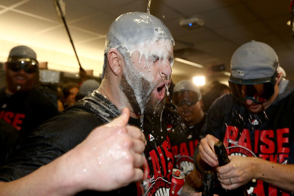 TORONTO, ON - OCTOBER 19:  Mike Napoli #26 of the Cleveland Indians celebrates with his teammates in the locker room after defeating the Toronto Blue Jays with a score of 3 to 0 in game five to win the American League Championship Series at Rogers Centre on October 19, 2016 in Toronto, Canada.  (Photo by Elsa/Getty Images)