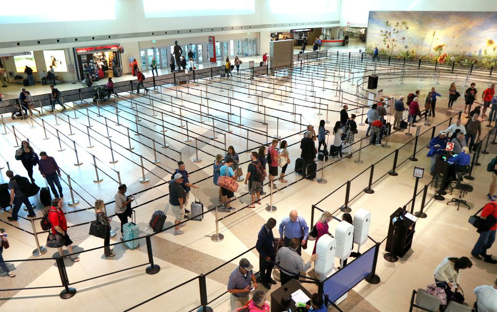 Passengers wait in line at a security checkpoint at Dallas Love Field on Oct. 19, 2017.