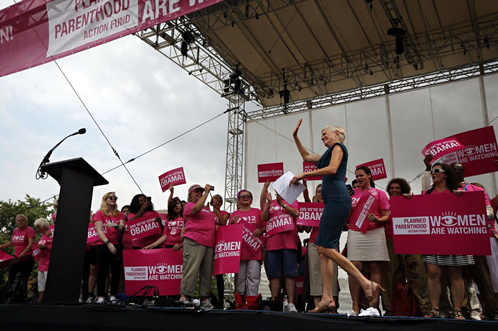 """Cecile Richards, president of Planned Parenthood, waves to the crowd during the """"Yes We Plan"""" rally at the 2012 Democratic National Convention in Charlotte, N.C."""