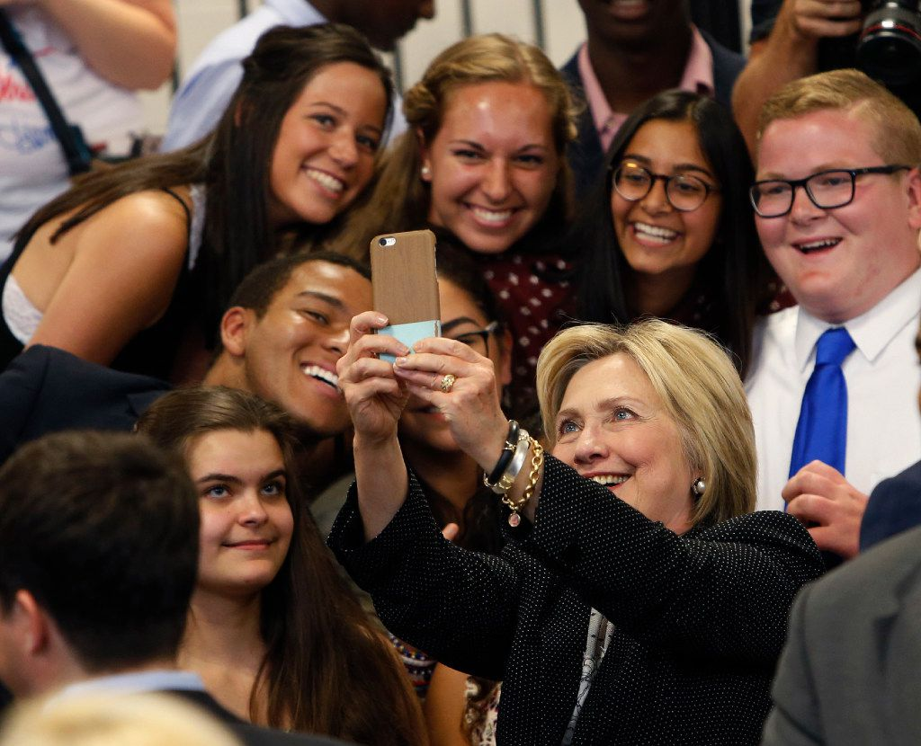 FILE - Democratic presidential candidate Hillary Clinton takes a photo with supporters after speaking at Fort Hayes Vocational School in Columbus, Ohio. (AP Photo/Jay LaPrete, File)