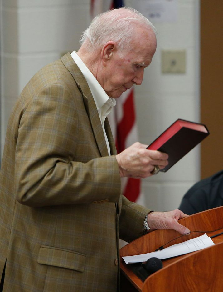 Gale Galloway, former Chairman of the Board of Regents at Baylor University, pauses as he glances at his notes as he holds a bible while speaking in favor of the school board's decision to hire Art Briles. The meeting of the Mount Vernon ISD Board was the first since naming Art Briles as its head football coach. The Meeting was held in the High School Lecture Hall in Mount Vernon on June, 17, 2019.  (Steve Hamm/ Special Contributor)