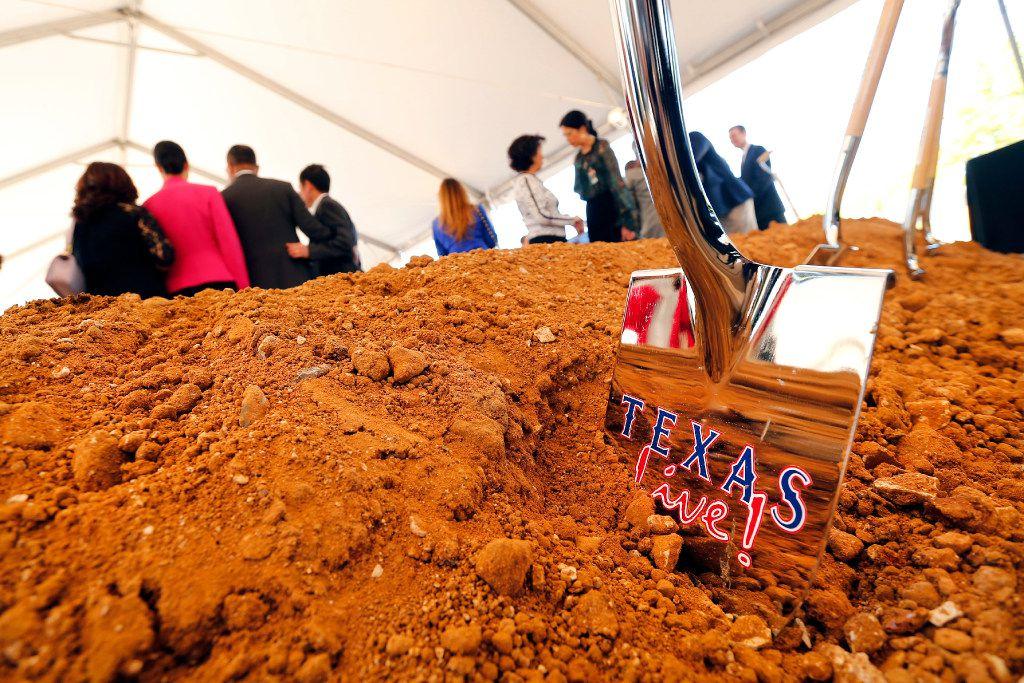 A ceremonial shovel is left in the dirt following the groundbreaking for Texas Live! in Arlington on Wednesday. In partnership between The Cordish Companies and the Texas Rangers, Texas Live! is a $250 million dining, entertainment and hospitality district to be built adjacent to the new Rangers indoor stadium. (Tom Fox/Staff Photographer)