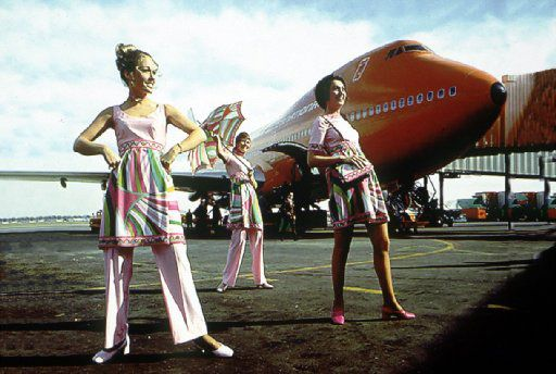 Braniff flight attendants model their Pucci uniforms on the tarmac.