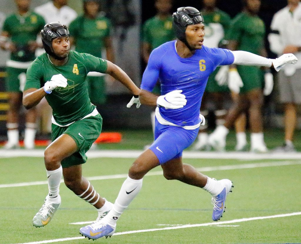 Jahari Rogers (4) of Arlington High School, defends Koy Moore (6) of Arshbishop Rummel High School in Louisianna during The Opening Finals, a football camp featuring some of the top high school recruits in the country. The final day of the event was held at The Star in Frisco on  Wednesday, July 3, 2019.  (Stewart F. House/Special Contributor)